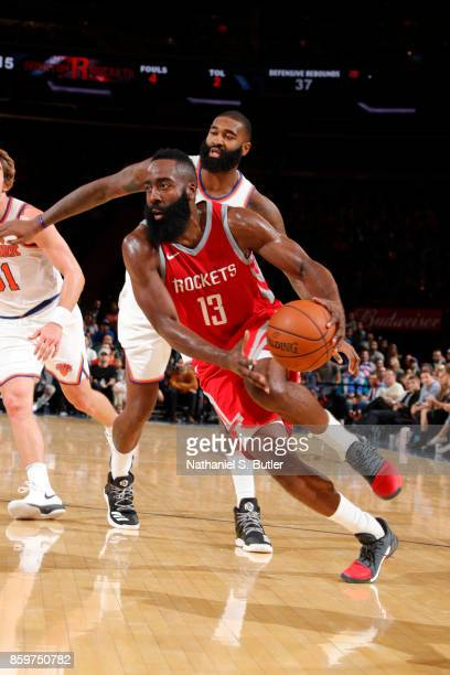 James Harden of the Houston Rockets drives to the basket against the New York Knicks during the preseason game on October 9 2017 at Madison Square...