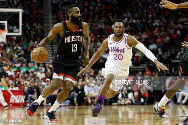 James Harden of the Houston Rockets drives to the basket defended by Josh Okogie of the Minnesota Timberwolves in the first half at Toyota Center on...