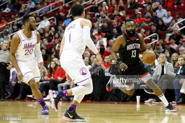 James Harden of the Houston Rockets drives to the basket defended by Josh Okogie of the Minnesota Timberwolves and Tyus Jones in the first half at...