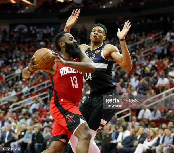 James Harden of the Houston Rockets drives to the basket defended by Giannis Antetokounmpo of the Milwaukee Bucks in the second half at Toyota Center...