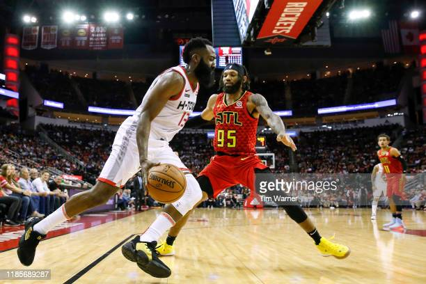 James Harden of the Houston Rockets drives to the basket defended by DeAndre' Bembry of the Atlanta Hawks in the first half at Toyota Center on...