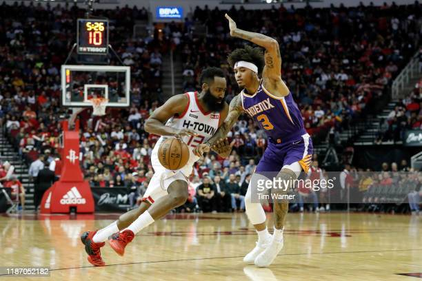 James Harden of the Houston Rockets drives to the basket defended by Kelly Oubre Jr #3 of the Phoenix Suns in the second half at Toyota Center on...