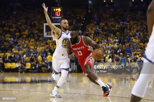 James Harden of the Houston Rockets drives with the ball against Stephen Curry of the Golden State Warriors during Game Three of the Western...