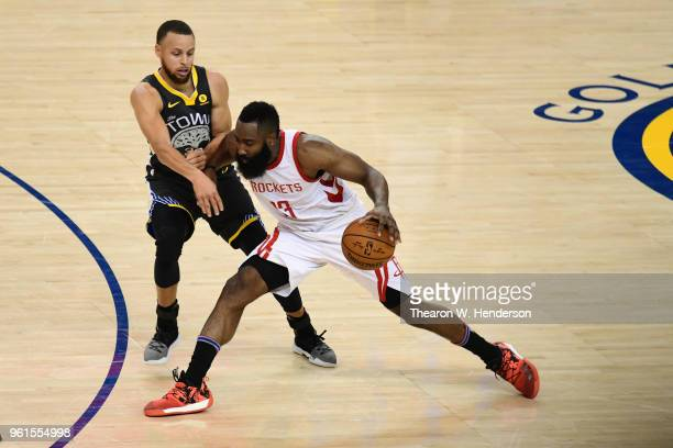 James Harden of the Houston Rockets drives with the ball against Stephen Curry of the Golden State Warriors during Game Four of the Western...