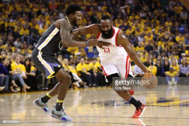 James Harden of the Houston Rockets drives with the ball against Jordan Bell of the Golden State Warriors during Game Four of the Western Conference...