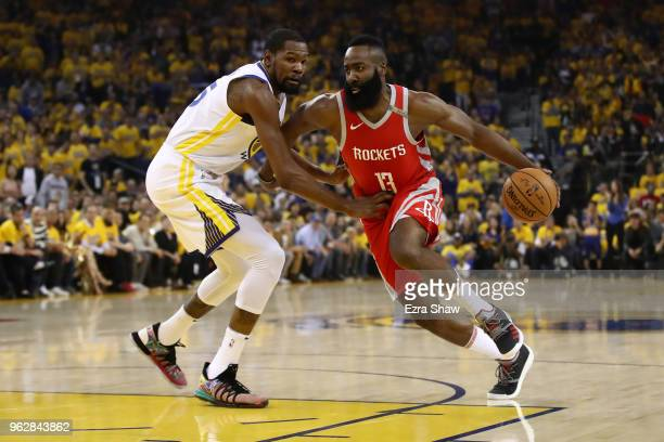 James Harden of the Houston Rockets drives with the ball against Kevin Durant of the Golden State Warriors during Game Six of the Western Conference...