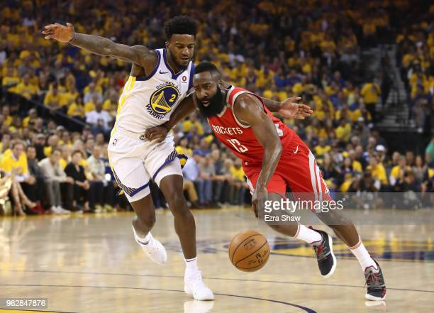 James Harden of the Houston Rockets drives with the ball against Jordan Bell of the Golden State Warriors during Game Six of the Western Conference...