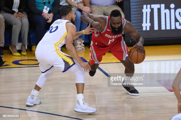 James Harden of the Houston Rockets drives with the ball against Stephen Curry of the Golden State Warriors during Game Six of the Western Conference...