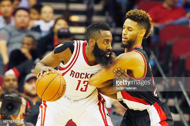 James Harden of the Houston Rockets drives with the basketball against Allen Crabbe of the Portland Trail Blazers during their game at the Toyota...