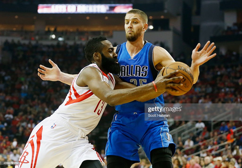 James Harden #13 of the Houston Rockets drives with the basketball against Chandler Parsons #25 of the Dallas Mavericks during their game at the Toyota Center on November 22, 2014 in Houston, Texas.