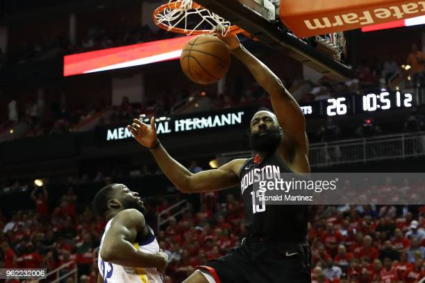 James Harden of the Houston Rockets dunks against Draymond Green of the Golden State Warriors in the first half of Game Five of the Western...
