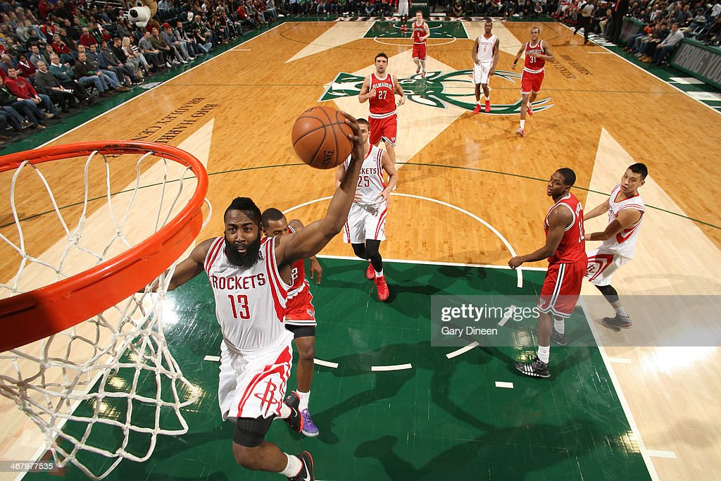 James Harden #13 of the Houston Rockets dunks against the Milwaukee Bucks on February 8, 2014 at the BMO Harris Bradley Center in Milwaukee, Wisconsin.