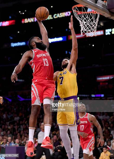James Harden of the Houston Rockets dunks over JaVale McGee of the Los Angeles Lakers during the second quarter at Staples Center on October 20 2018...