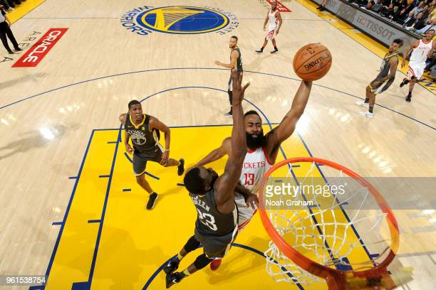 James Harden of the Houston Rockets dunks the ball against Draymond Green of the Golden State Warriors in Game Four of the Western Conference Finals...