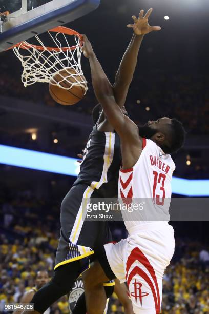 James Harden of the Houston Rockets dunks the ball against Draymond Green of the Golden State Warriors during Game Four of the Western Conference...