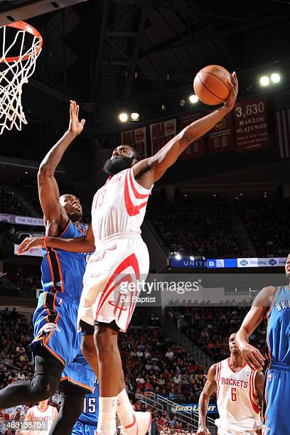 James Harden of the Houston Rockets dunks the ball against the Oklahoma City Thunder on January 16 2014 at the Toyota Center in Houston Texas NOTE TO...