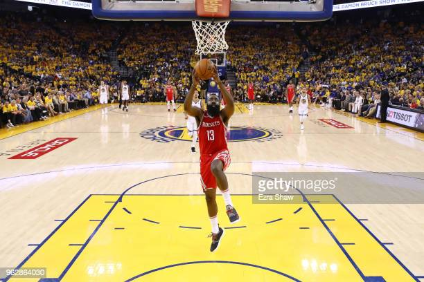 James Harden of the Houston Rockets dunks the ball against the Golden State Warriors during Game Six of the Western Conference Finals in the 2018 NBA...