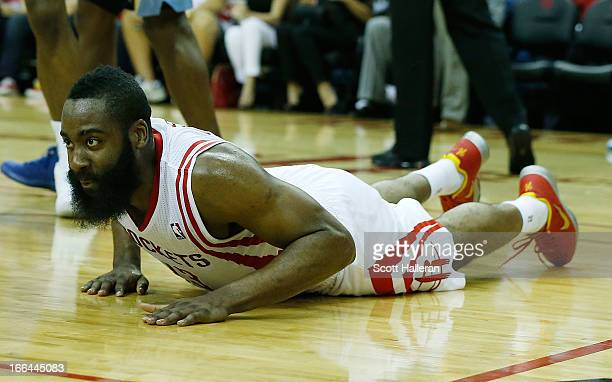 James Harden of the Houston Rockets falls to the court during the game against the Memphis Grizzlies at the Toyota Center on April 12 2013 in Houston...