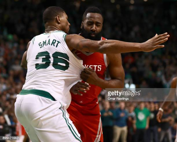 James Harden of the Houston Rockets fouls Marcus Smart of the Boston Celtics during the fourth quarter of the game at TD Garden on December 28 2017...