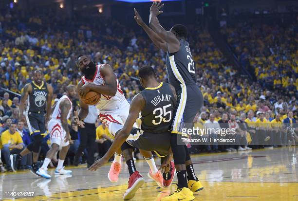 James Harden of the Houston Rockets gets commits an offensive foul against Kevin Durant of the Golden State Warriors in Game Two of the Second Round...