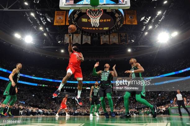 James Harden of the Houston Rockets goes to the basket against the Boston Celtics on March 3 2019 at the TD Garden in Boston Massachusetts NOTE TO...