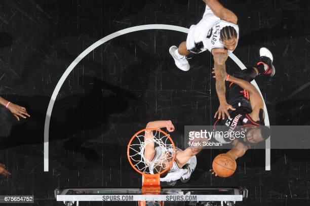 James Harden of the Houston Rockets goes up for a lay up against the San Antonio Spurs during Game One of the Western Conference Semifinals of the...