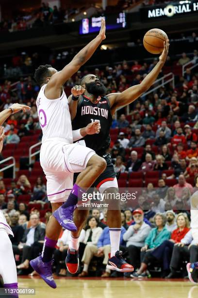 James Harden of the Houston Rockets goes up for a lay up defended by Josh Okogie of the Minnesota Timberwolves in the first half at Toyota Center on...