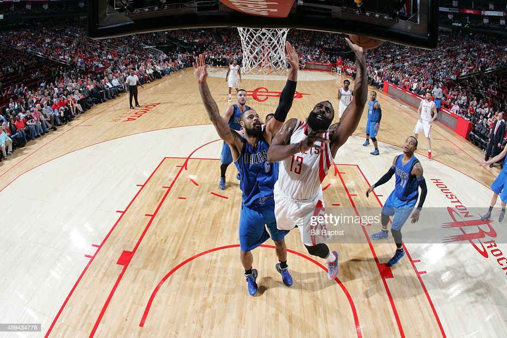 James Harden #13 of the Houston Rockets goes up for a layup against the Dallas Mavericks during the game on November 22, 2014 at the Toyota Center in Houston, Texas.