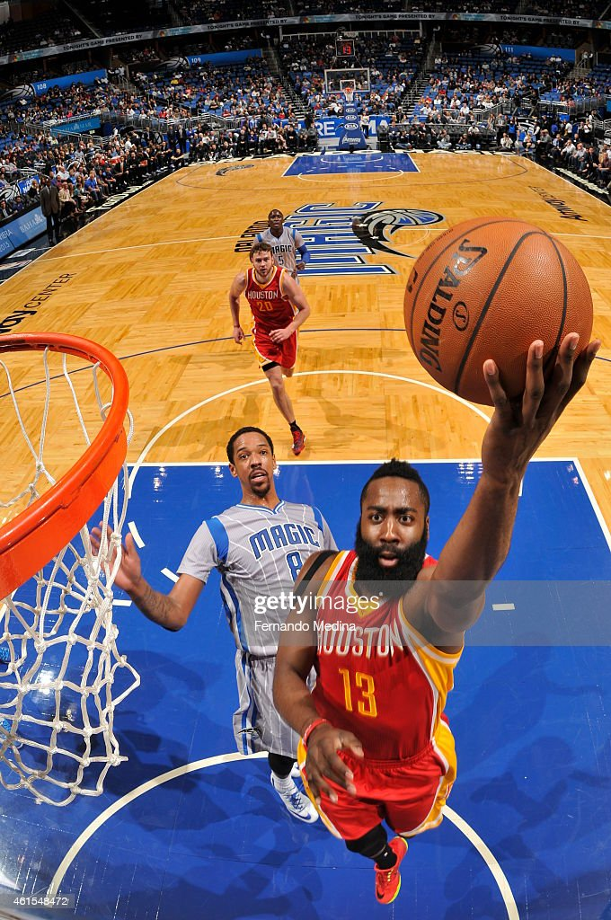 James Harden #13 of the Houston Rockets goes up for a shot against the Orlando Magic during the game on January 14, 2015 at Amway Center in Orlando, Florida.