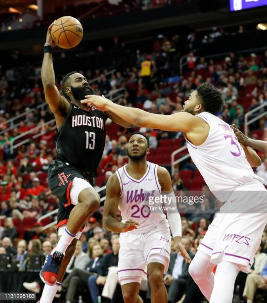 James Harden of the Houston Rockets goes up for a shot defended by KarlAnthony Towns of the Minnesota Timberwolves and Josh Okogie in the first half...