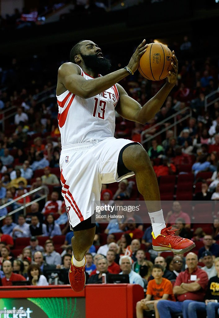 James Harden #13 of the Houston Rockets goes up for a shot during the game against the Minnesota Timberwolves at Toyota Center on March 15, 2013 in Houston, Texas.