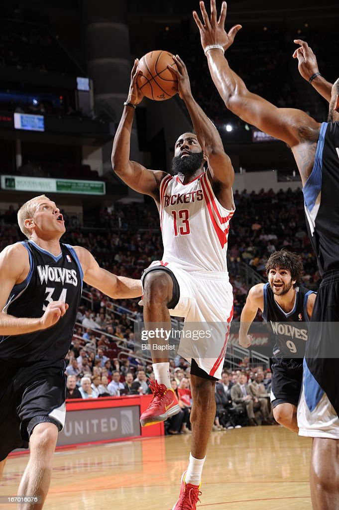 James Harden #13 of the Houston Rockets goes up for the layup against Greg Stiemsma #34 of the Minnesota Timberwolves on March 15, 2013 at the Toyota Center in Houston, Texas.