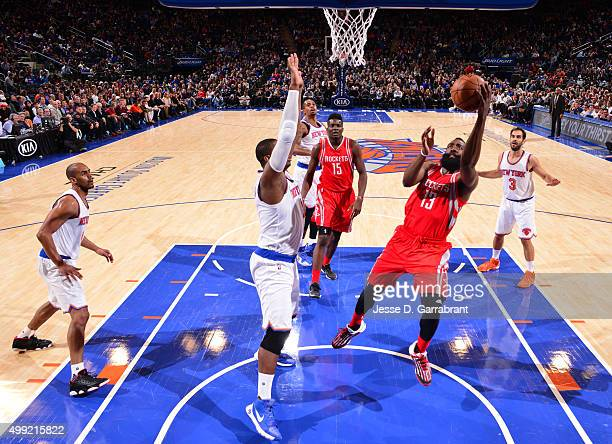 James Harden of the Houston Rockets goes up for the layup in traffic against the New York Knicks at Madison Square Garden on November 29 2015 in New...