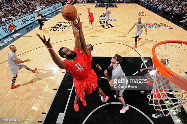 James Harden of the Houston Rockets grabs a rebound against the San Antonio Spurs during the game at the ATT Center on December 25 2013 in San...