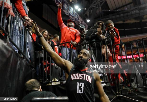 James Harden of the Houston Rockets greets fans on the way to the locker room after the game against the Los Angeles Lakers at Toyota Center on...