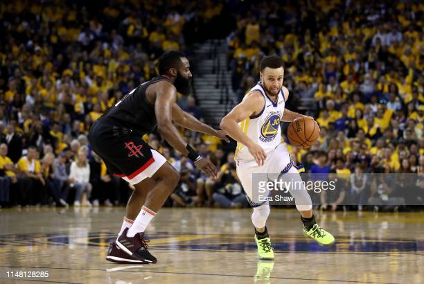 James Harden of the Houston Rockets guards Stephen Curry of the Golden State Warriors during Game Five of the Western Conference Semifinals of the...