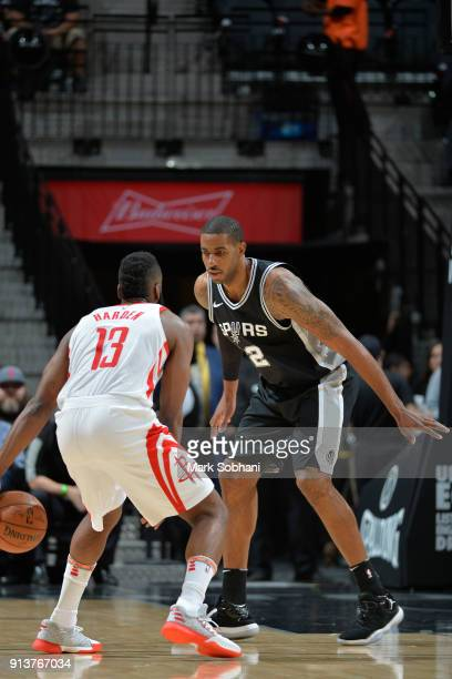 James Harden of the Houston Rockets handles the ball against Kawhi Leonard of the San Antonio Spurs during the game between the two teams on February...