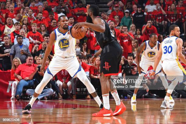 James Harden of the Houston Rockets handles the ball against Kevin Durant of the Golden State Warriors during Game Two of the Western Conference...