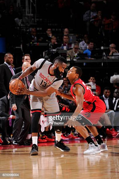 James Harden of the Houston Rockets handles the ball against Kyle Lowry of the Toronto Raptors during a game on November 23 2016 at the Toyota Center...