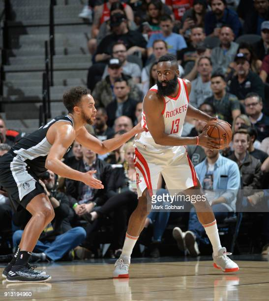 James Harden of the Houston Rockets handles the ball against Kyle Anderson of the San Antonio Spurs on February 1 2018 at the ATT Center in San...