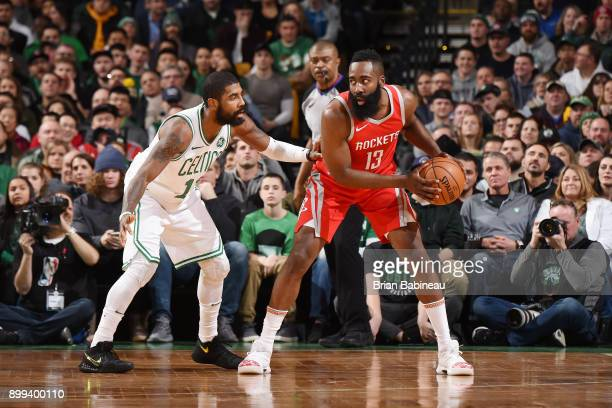 James Harden of the Houston Rockets handles the ball against Kyrie Irving of the Boston Celticsl on December 28 2017 at the TD Garden in Boston...