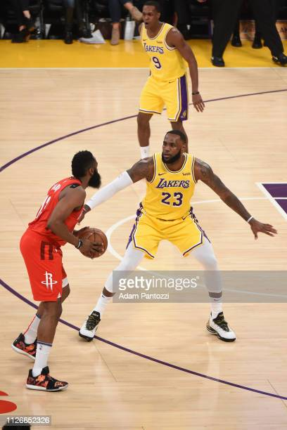 James Harden of the Houston Rockets handles the ball against LeBron James of the Los Angeles Lakers on February 21 2019 at STAPLES Center in Los...