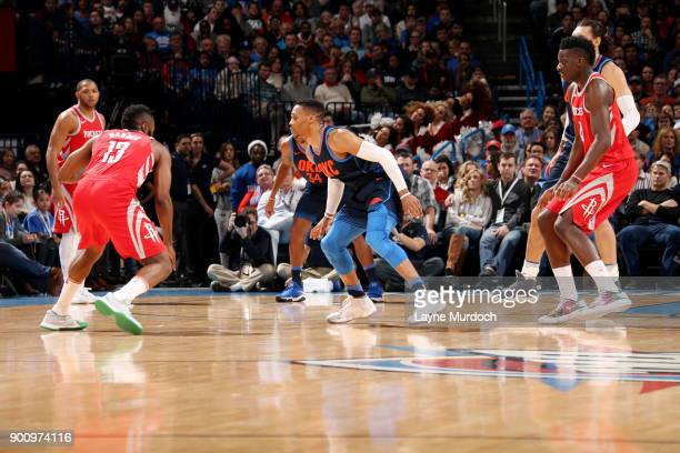 James Harden of the Houston Rockets handles the ball against Russell Westbrook of the Oklahoma City Thunder during the game between the two teams on...