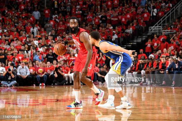 James Harden of the Houston Rockets handles the ball against Stephen Curry of the Golden State Warriors during Game Six of the Western Conference...