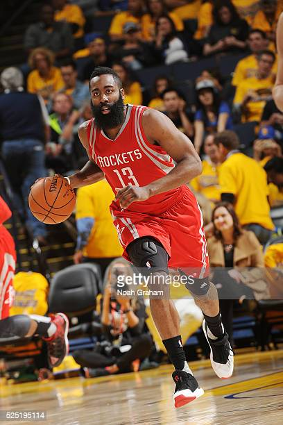 James Harden of the Houston Rockets handles the ball against the Golden State Warriors in Game Five of the Western Conference Quarterfinals during...