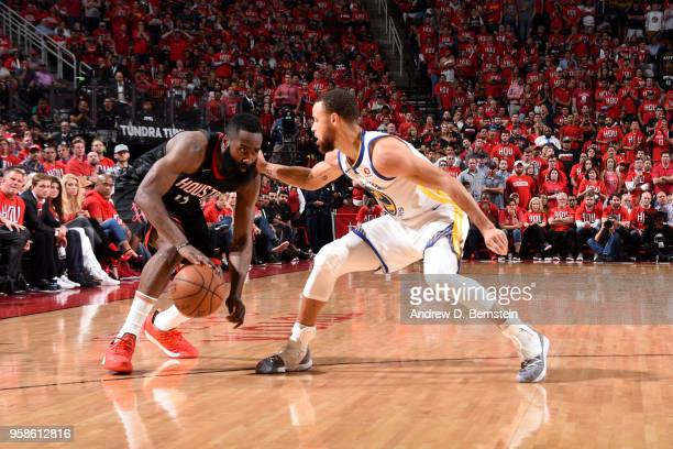 James Harden of the Houston Rockets handles the ball against the Golden State Warriors during Game One of the Western Conference Finals of the 2018...