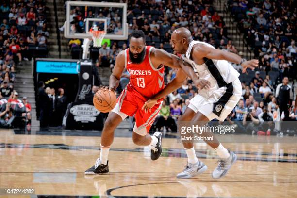 James Harden of the Houston Rockets handles the ball against the San Antonio Spurs during a preseason game on October 7 2018 at the ATT Center in San...