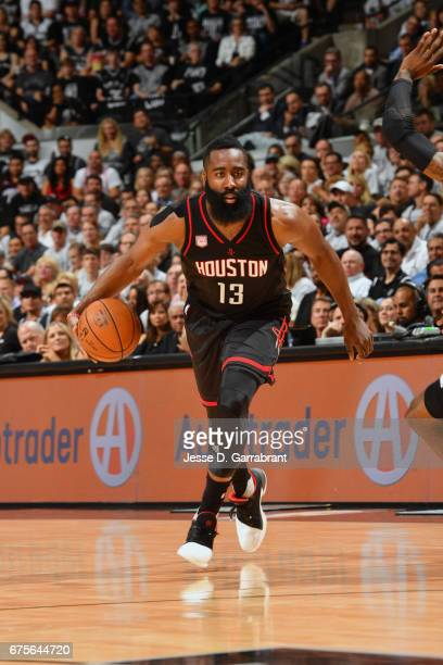 James Harden of the Houston Rockets handles the ball against the San Antonio Spurs during Game One of the Western Conference Semifinals of the 2017...