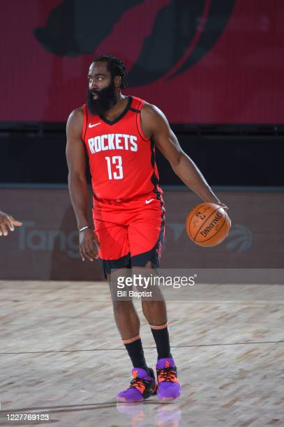 James Harden of the Houston Rockets handles the ball during a scrimmage against the Toronto Raptors on July 24, 2020 at The Arena at ESPN Wide World...