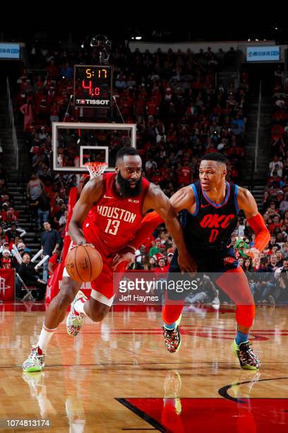 James Harden of the Houston Rockets handles the ball during the game against Russell Westbrook of the Oklahoma City Thunder on December 25 2018 at...